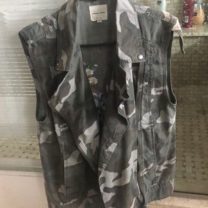 Army vest with Flowers on the back good condition